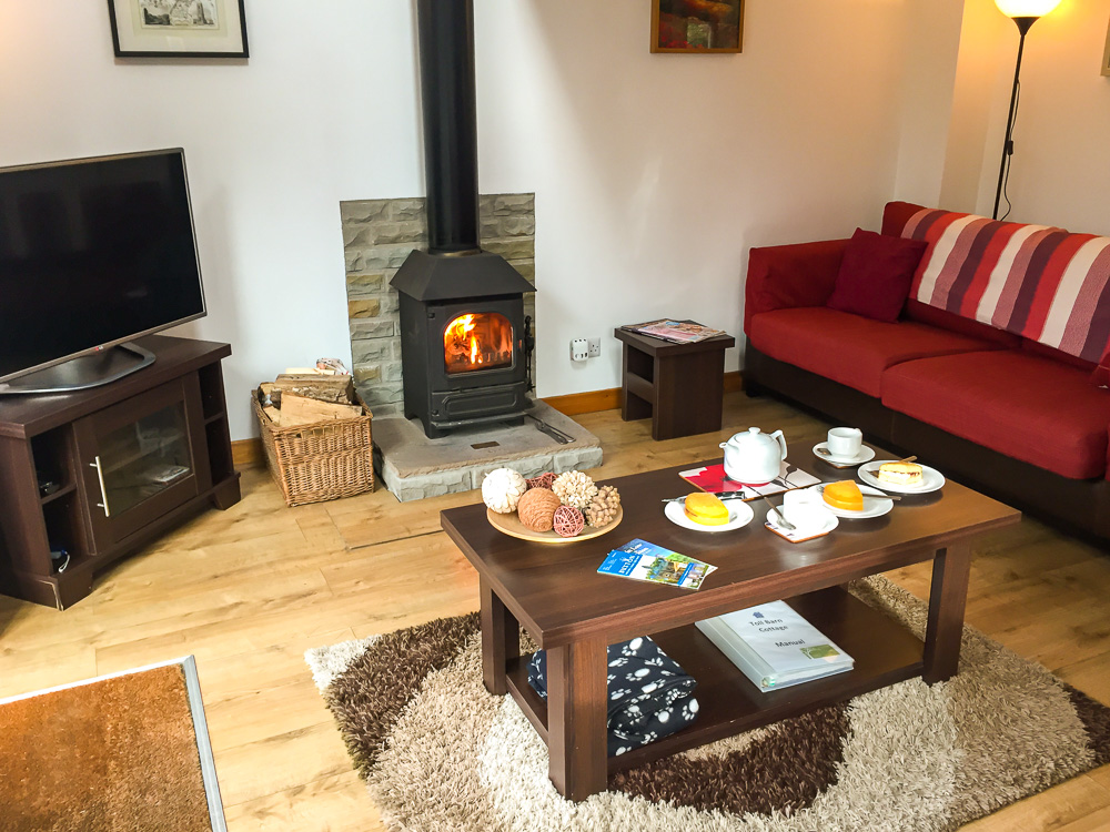Lounge and wood burner in the converted barn accommodation